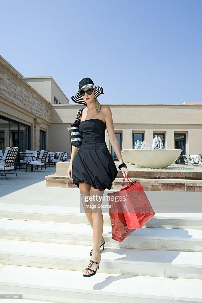 Stylish woman with shopping bags : Bildbanksbilder