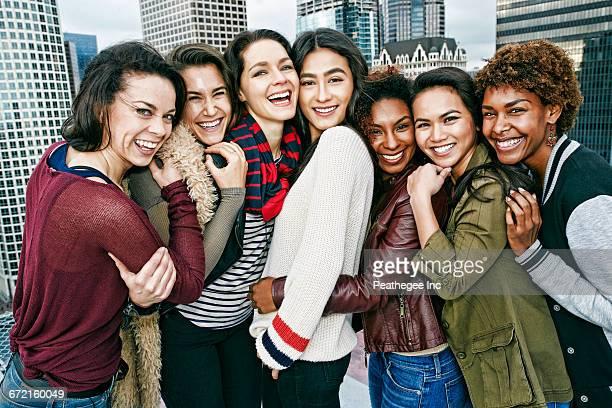 Stylish women posing on urban rooftop