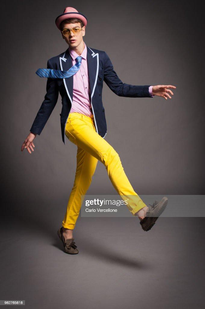 Stylish young adult male model posing : Stock Photo