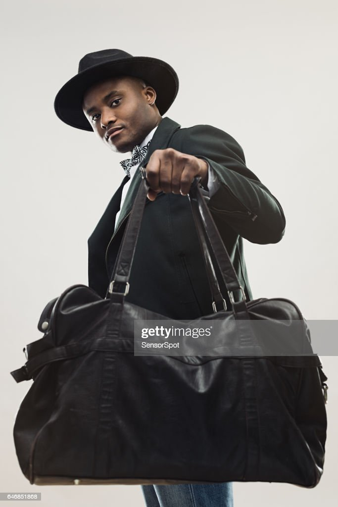 Stylish young african man with handbag : Stock Photo