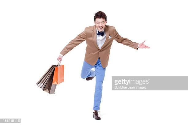 Stylish young businessman with shopping bags