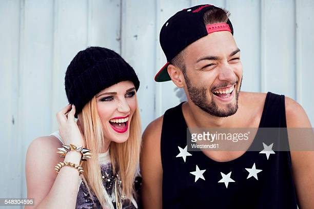Stylish young couple laughing