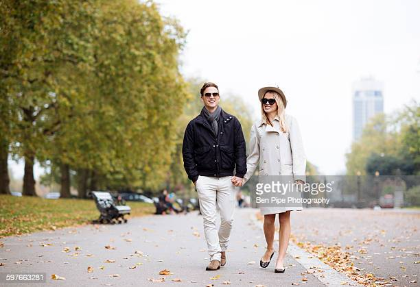 Stylish young couple strolling in park, London, England, UK