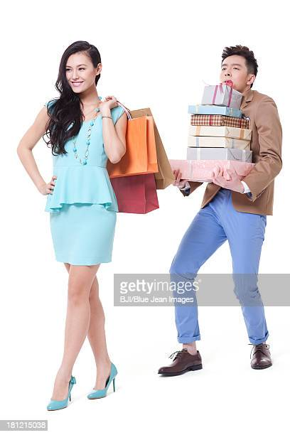 Stylish young couple with shopping bags