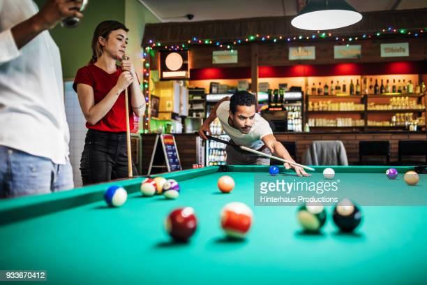 stylish young friends playing pool together - poolbillard billard stock-fotos und bilder