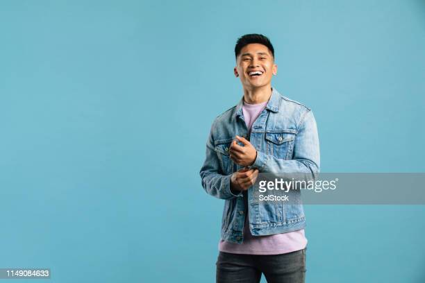 stylish young man in a studio - blue shirt stock pictures, royalty-free photos & images