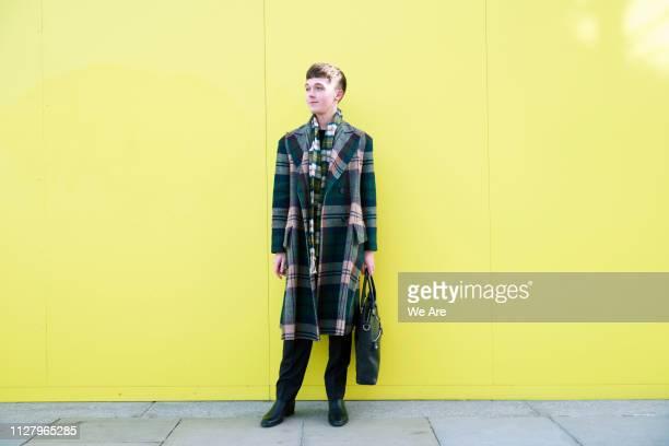 stylish young man in plaid jacket. - masculinidad moderna fotografías e imágenes de stock