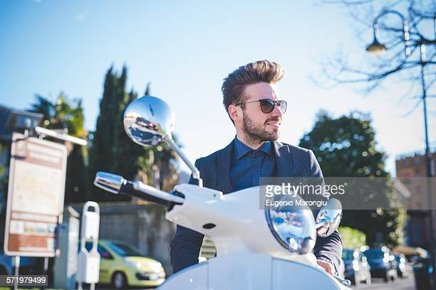 Stylish young man on moped