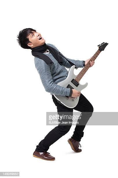 Stylish young man playing guitar