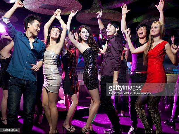 stylish young people dancing in nightclub - cocktail dress stock pictures, royalty-free photos & images