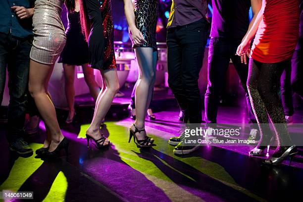 Stylish young people dancing in nightclub