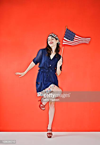 Stylish Young Woman Holding American Flag