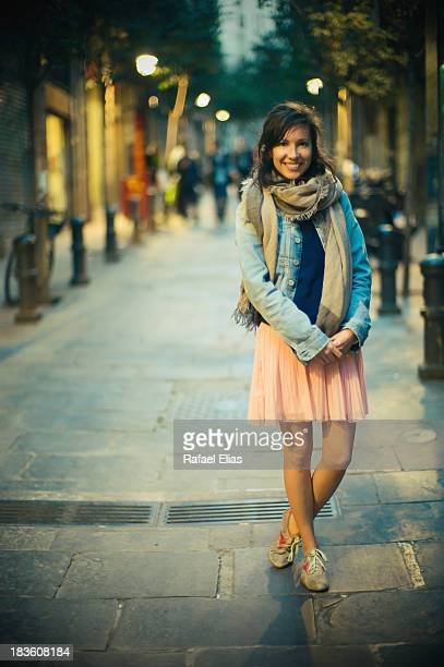 Stylish young woman in the street at night