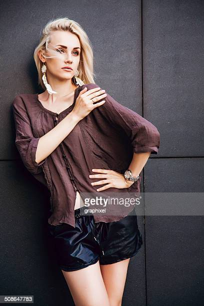 Stylish young woman posing outdoors