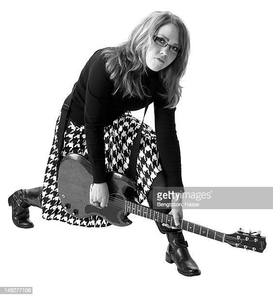 Stylish young woman posing with Epithione electric guitar
