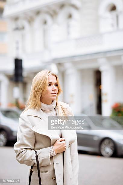 stylish young woman waiting on street, london, england, uk - kensington and chelsea stock pictures, royalty-free photos & images