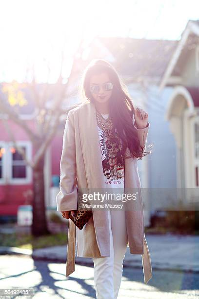 Stylish Young Woman Walking Down The Street