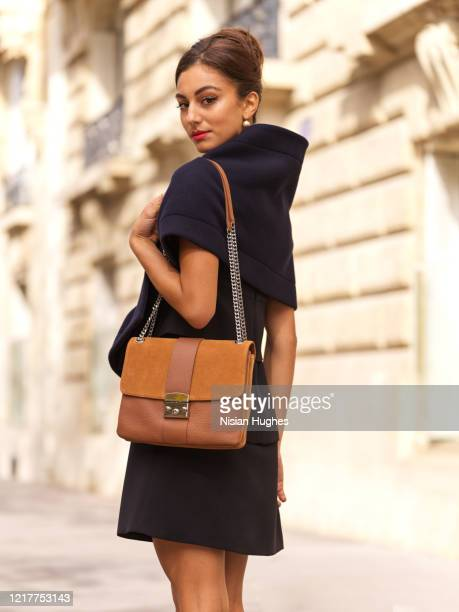 stylish young woman with purse daytime, paris france - brown purse stock pictures, royalty-free photos & images