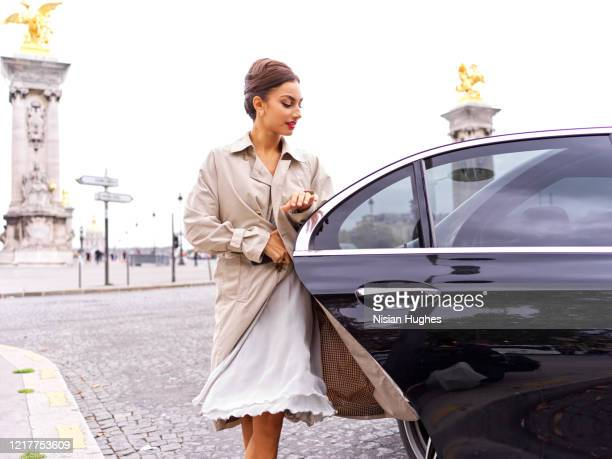 stylish young women getting out of back of car, daytime - leaving stock pictures, royalty-free photos & images