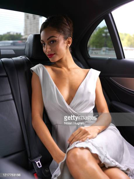 stylish young women in back seat of car, daytime - v neck stock pictures, royalty-free photos & images