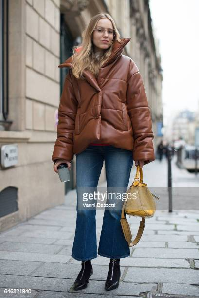 Stylist Alexandra Carl poses with a Loewe bag after the Courreges show during Paris Fashion Week Womenswear FW 17/18 on March 1 2017 in Paris France