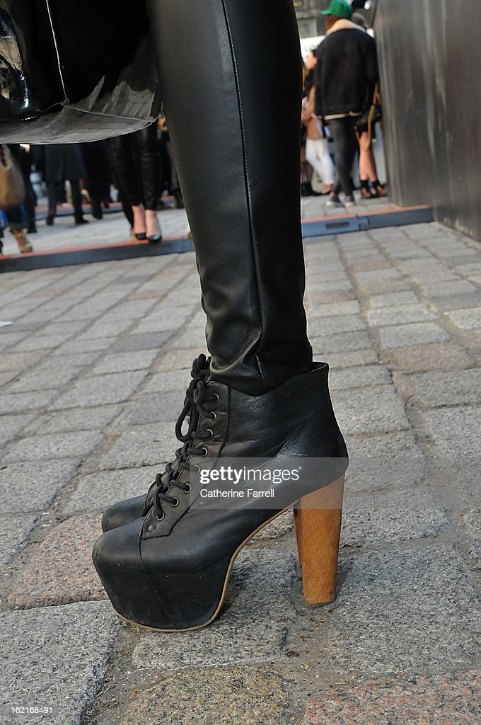 Stylist and Blogger Olivia Akot wears Jeffrey Campbell boots from Festival Shoes in Brick Lane during London Fashion Week Fall/Winter 2013/14 on February 19, 2013 in London, England.