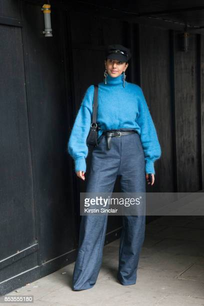 Stylist and costume designer Payzee Malika wears an HM jumper and earrings her own design trousers Simmi shoes Dior bag Asos hat and vintage glasses...