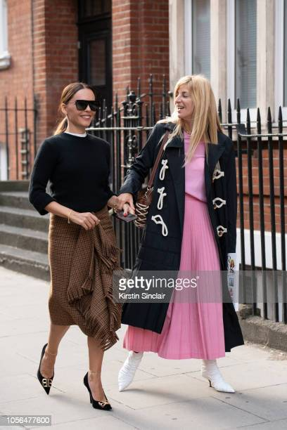 Stylist and Creative consultant Evangeline Smyrniotaki wears a Balenciaga skirt and shoes and a black sweater with Fashion stylist and consultant Ada...