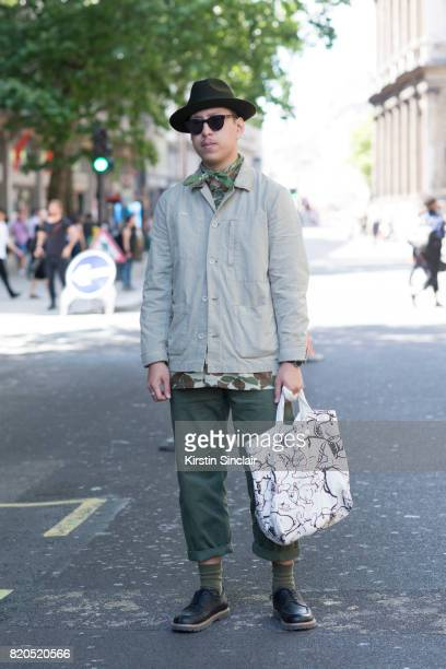 Stylist and creative director John Jarrett wears Birkenstock shoes Top man trousers Levi's Camouflage shirt AG denim jacket Laird and Co hat vintage...