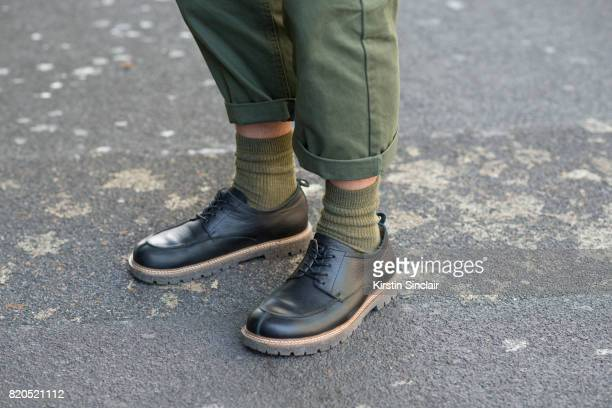 Stylist and creative director John Jarrett wears Birkenstock shoes and Top man trousers on day 3 of London Collections: Men on June 11, 2017 in...
