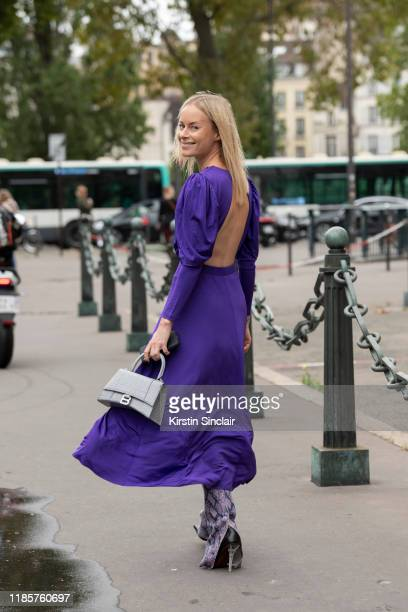 Stylist and creative director Thora Valdimars wears a Rotate dress, Balenciaga bag, Staud trousers and Vetements boots on September 26, 2019 in...