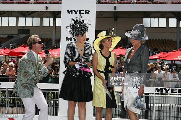 MC stylist and fashion tv personality Carson Kressley announces Lorraine Cookson as winner of the Fashions On The Field best dressed award during the...