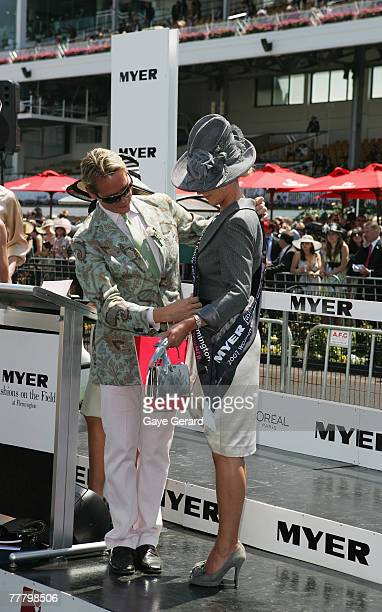 MC stylist and fashion tv personality Carson Kressley places the Fashions on the Field best dressed winner's sash on Lorraine Cookson during the Myer...