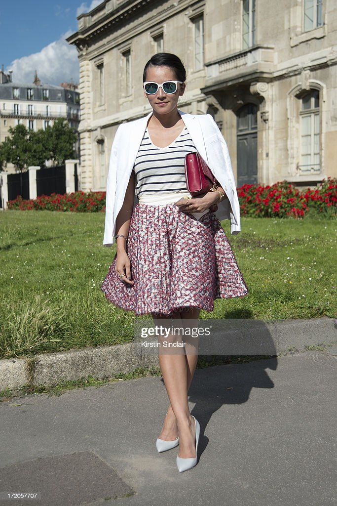 Stylist and fasion writer Tina Leung wears Sunpocket sunglasses, Brookes brothers for Thom Browne jacket, Zara vest, Louis Vuitton bag, Jourden skirt and Rupert Sanderson shoes on day 5 of Paris Collections: Men on June 30, 2013 in Paris, France.