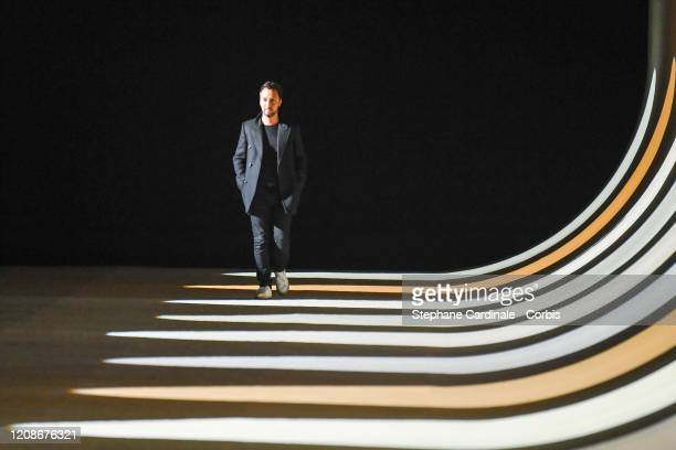 Stylist Anthony Vaccarello walks the runway during the Saint Laurent show as part of the Paris Fashion Week Womenswear Fall/Winter 2020/2021 on...