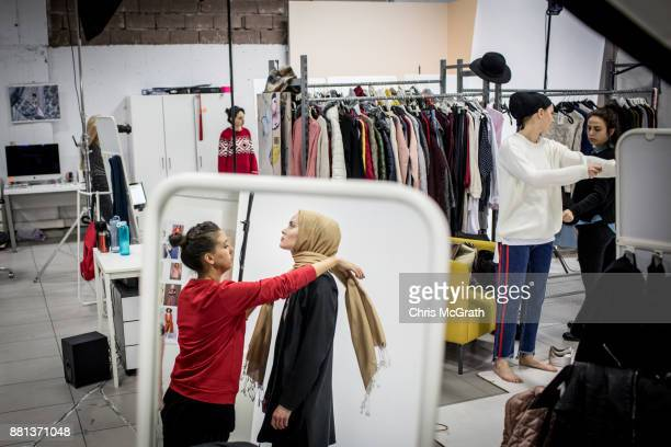A stylist assists a model during a photo session for online modest clothing brand Modanisa on November 28 2017 in Istanbul Turkey Modest fashion and...