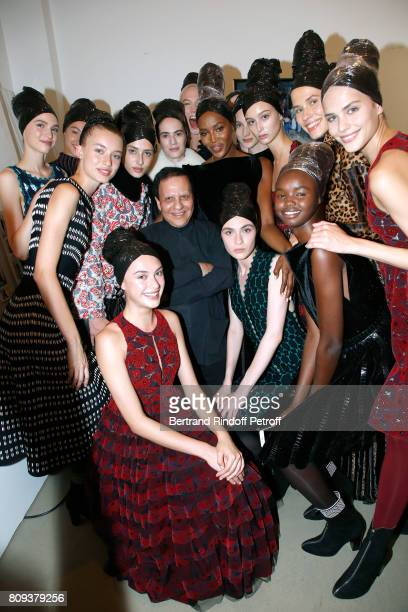 Stylist Azzedine Alaia poses with Naomi Campbell and other models after the Azzedine Alaia Fashion Show as part of Haute Couture Paris Fashion Week...