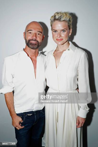 Stylist Bertrand Guyon and Alice Eve pose after the Schiaparelli Haute Couture Fall Winter 2018/2019 show as part of Paris Fashion Week on July 2...