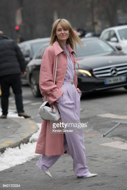 Stylist blogger and creative consultant Jeanette Friis Madsen wears a Manu Atelier bag Stine Goya jacket Tibi suit and Celine boots day 4 of Paris...