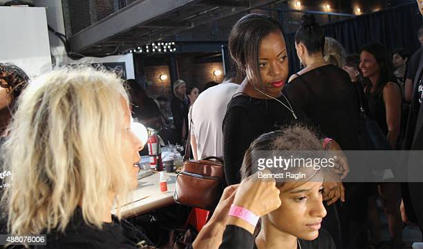 Stylist BokHee and designer Tracy Reese prepare a model backstage with SheaMoisture at Tracy Reese S/S 2016 during New York Fashion Week at Art Beam...