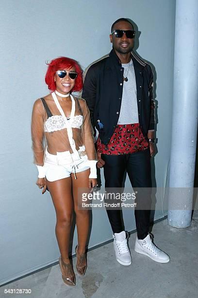 NBA Stylist Calyann Barnett and Basketball player Dwyane Wade attend the Lanvin Menswear Spring/Summer 2017 show as part of Paris Fashion Week on...