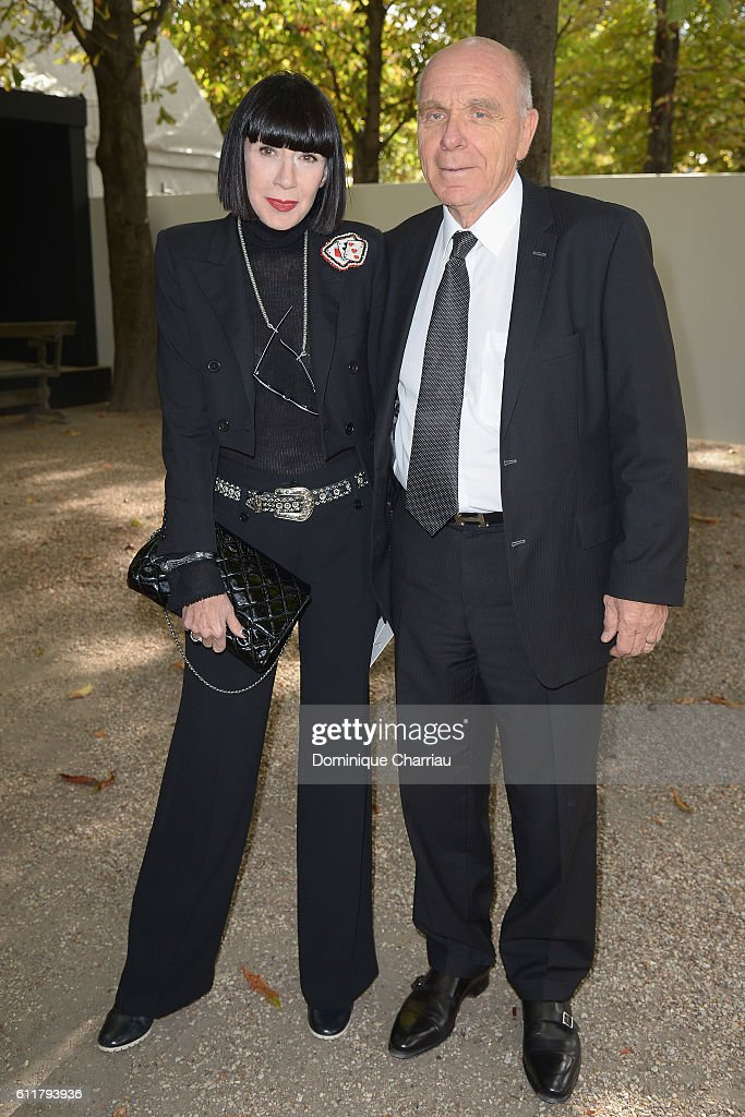 Stylist Chantal Thomass and her husband Michel Fabian attend the Elie Saab show as part of the Paris Fashion Week Womenswear Spring/Summer 2017 on October 1, 2016 in Paris, France.