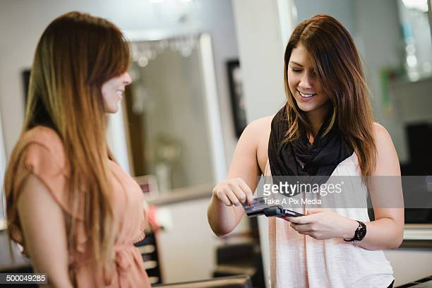 Stylist charging client's credit card in salon