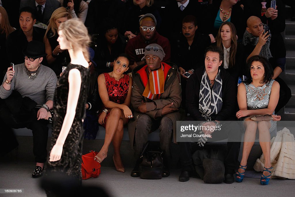 Stylist Chriselle Lim, Angela Simmons, and TV personality J Alexander attend the Tadashi Shoji Fall 2013 fashion show during Mercedes-Benz Fashion Week at The Stage at Lincoln Center on February 7, 2013 in New York City.