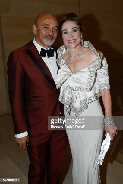 Stylist Christian Louboutin and Becca Cason Thrash attend the Liaisons au Louvre IV Evening of patronage for the benefit of the Louvre Museum at...