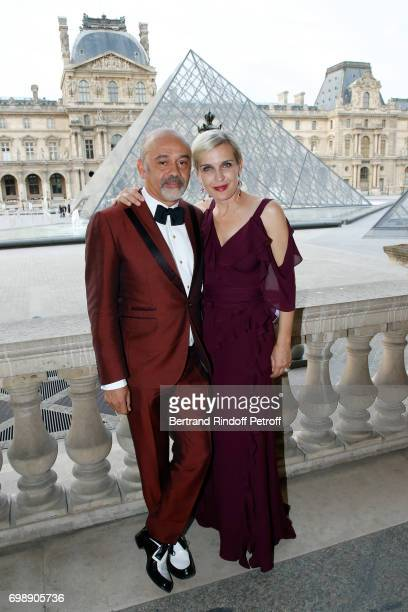 Stylist Christian Louboutin and Melita Toscan du Plantier attend the 'Liaisons au Louvre IV' Evening of patronage for the benefit of the Louvre...