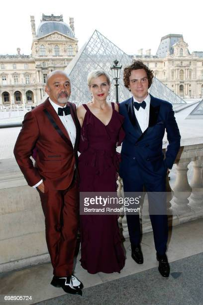 Stylist Christian Louboutin Melita Toscan du Plantier and EIC Esquire Jay Fielden attend the 'Liaisons au Louvre IV' Evening of patronage for the...