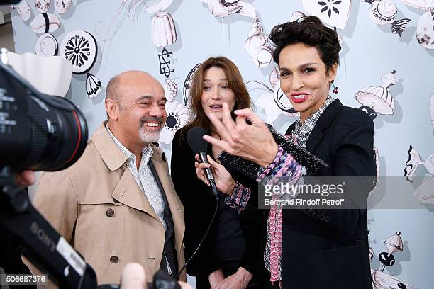 Stylist Christian Louboutin Singer Carla Bruni Sarkozy and Ambassador of the house Schiaparelli Farida Khelfa attend the Schiaparelli Haute Couture...