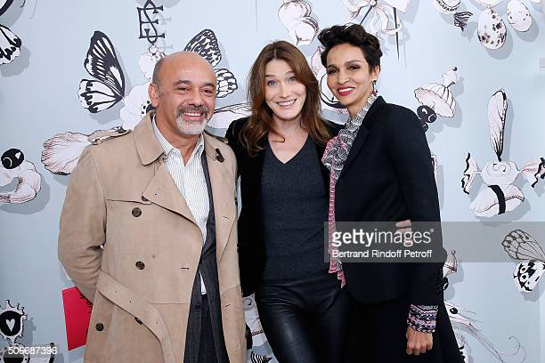 Stylist Christian Louboutin Singer Carla Bruni Sarkozy and Ambassador of the house Schiaparelli Farida Khelfa attend the Schiaparelli Haute Couture...