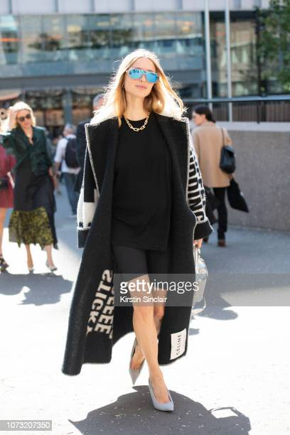Stylist Cofounder and Creative Director at Social Zoo Pernille Teisbaek wears a Celine coat and sunglasses Balenciaga shoes Wardrobe NYC cycling...
